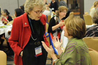 Jean Lipman-Blumen discussing with another conference participant