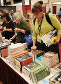 Photo of participants at ILA 2016 Book Store perusing and purchasing books