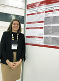 Amber Manning-Ouellette Stands Next to Her Poster for the Emerging Scholars Research Consortium in Brussels