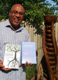 Stan Amaladas poses with his two new books