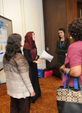 A Team Competes in the Poster Session of ILA's Student Case Competition at the Annual Global Conference