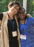 Two Participants Enjoying ILA's 3rd Biennial Women and Leadership Conference